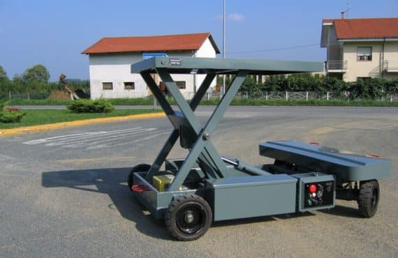 Radio-controlled trolley for handling industrial materials.